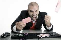 business guy wins money with online poker